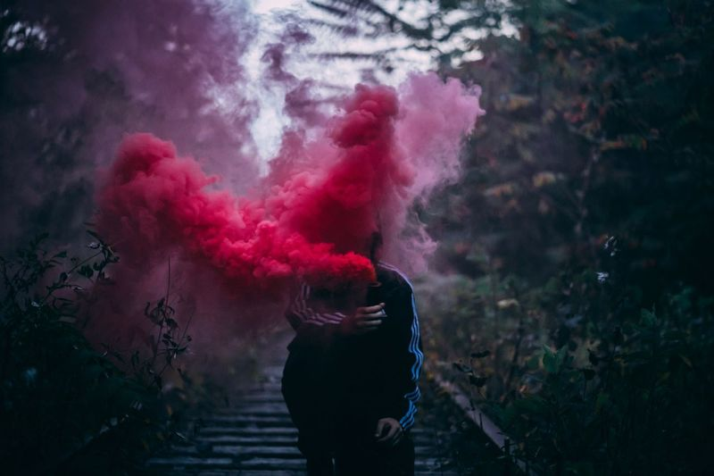 Smoke grenade shoot at an abandon railway. Nature Green Color Adidas Tones Tones Of Colour Moody Smoke Grenades Railway Track Train Tracks Smoke Red Color One Person Real People Lifestyles Leisure Activity Celebration Smoke - Physical Structure Motion Multi Colored Standing Pink Color Men Outdoors Three Quarter Length Day Nature Adult Red Women Casual Clothing