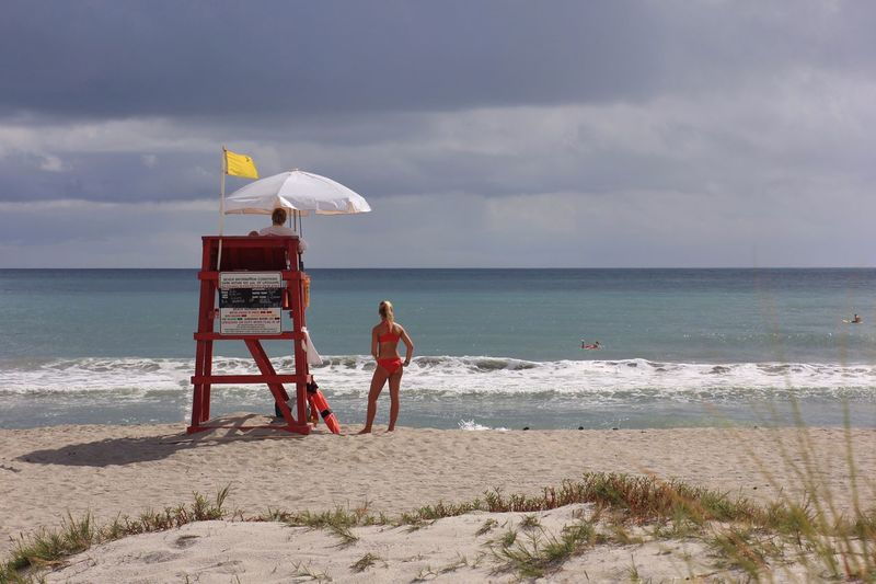 Life guard on duty Melbourne Beach, FL Life Guard Beach Photography Sand Bikini Bikini Time❤ Beach Seashore Life Guard Stand Beach Day Yellow Flag White Umbrella