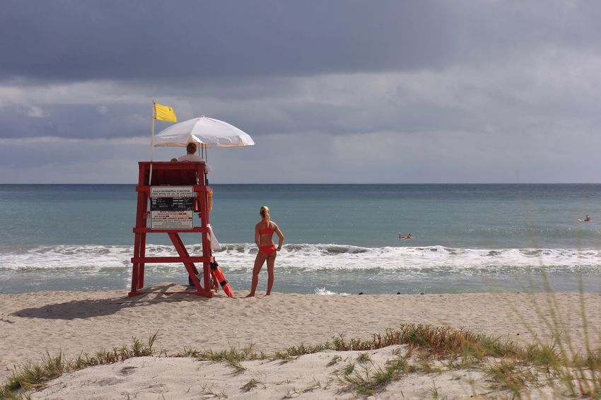 Life guard on duty Melbourne Beach, FL Life Guard Beach Photography Sand Bikini Bikini Time❤ Beach Seashore Life Guard Stand Beach Day Yellow Flag White Umbrella