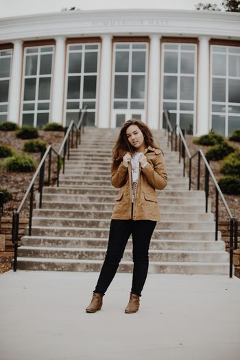 Adult Architecture Beautiful Woman Building Exterior Built Structure Casual Clothing Day Full Length Happiness Lifestyles One Person Outdoors People Real People Smiling Standing Steps Steps And Staircases Warm Clothing Women Young Adult Young Women