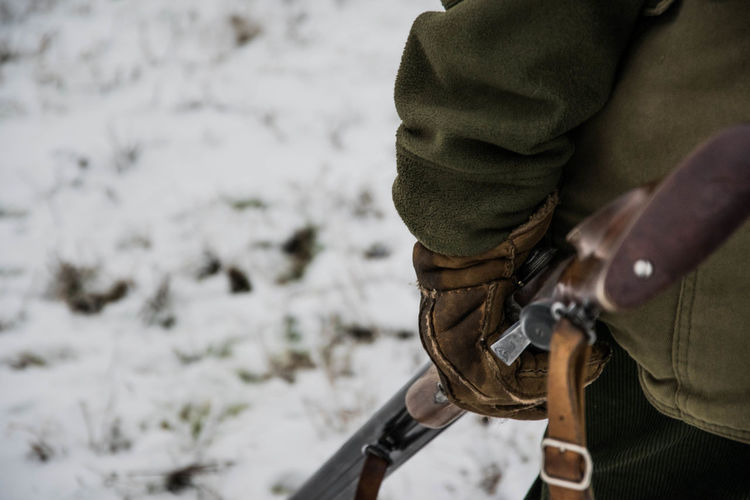 Close-Up Of Hunter In Snow