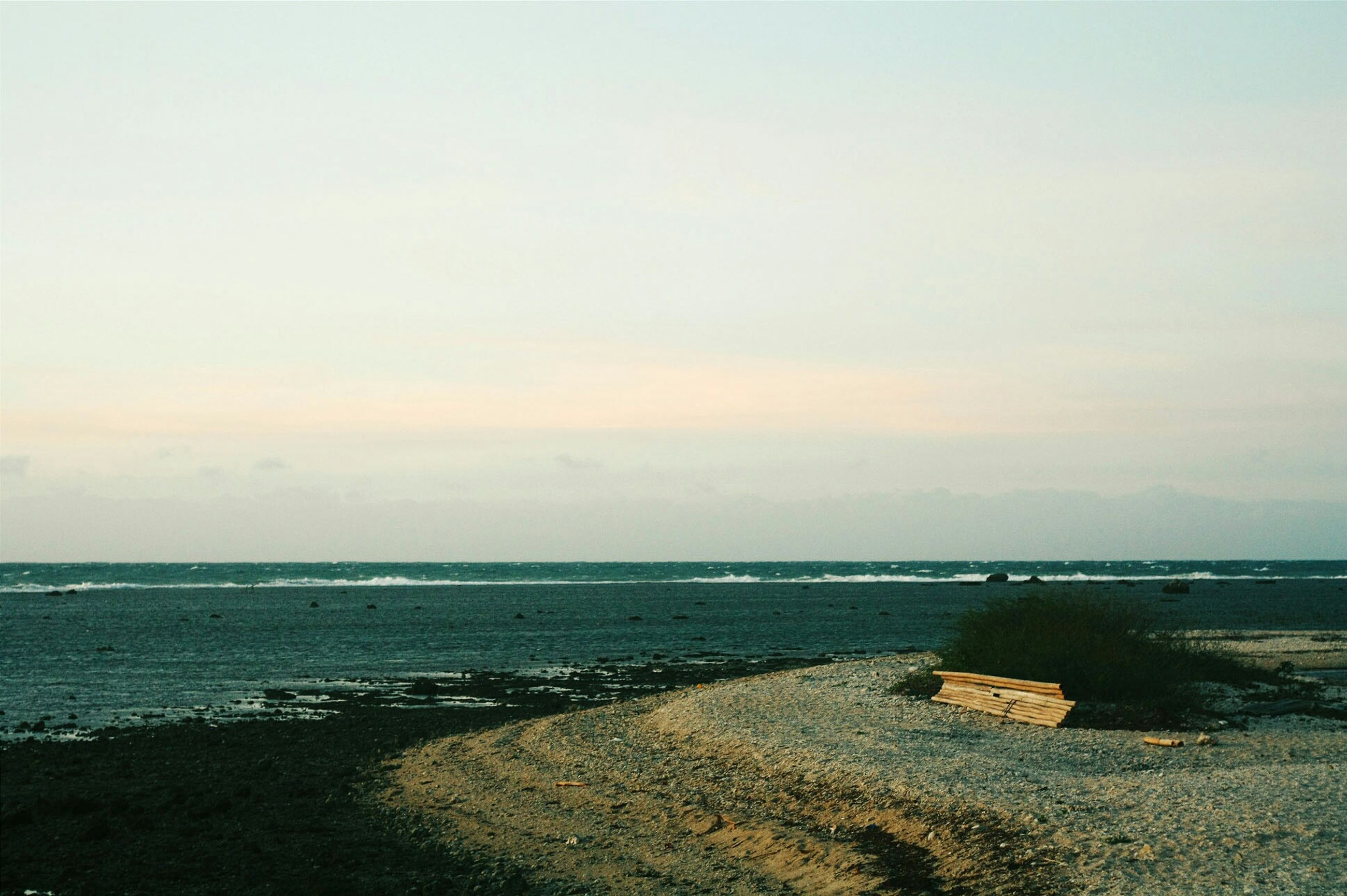 sea, water, horizon over water, tranquil scene, tranquility, scenics, beauty in nature, beach, sky, shore, nature, idyllic, copy space, coastline, remote, outdoors, non-urban scene, calm, no people, sunset