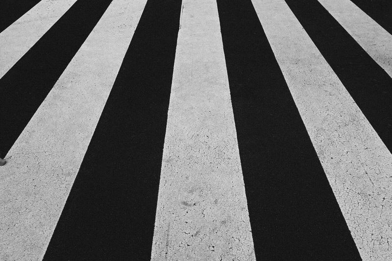 Zebra Pattern Asphalt Backgrounds City Crossing Crosswalk Day Dividing Line High Angle View Marking No People Outdoors Parallel Pattern Road Road Marking Safety Sign Street Striped Symbol Transportation Zebra Crossing