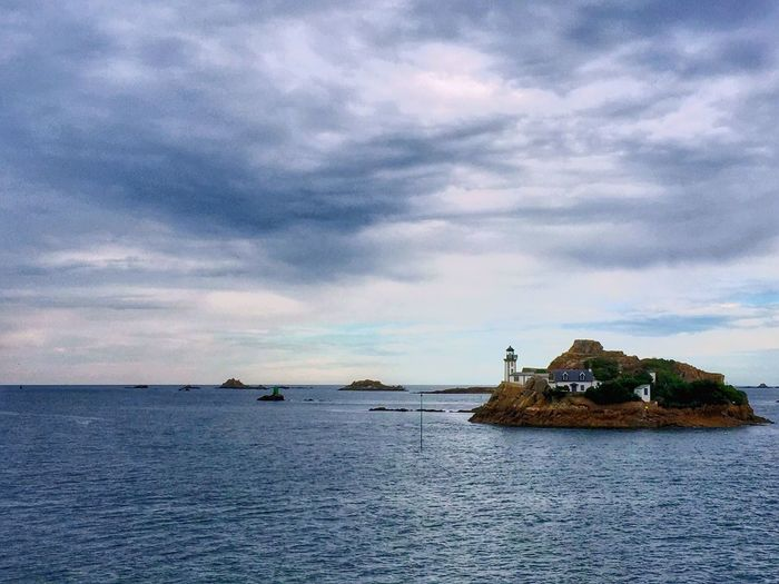 Sea Sky Cloud - Sky Water Scenics Waterfront Horizon Over Water Nature Outdoors Beauty In Nature Nautical Vessel Day Tranquil Scene No People Tranquility Built Structure Architecture Building Exterior Bretagne My Love Bretagnetourisme Bretagne Old-fashioned Lighthouse Leuchtturm