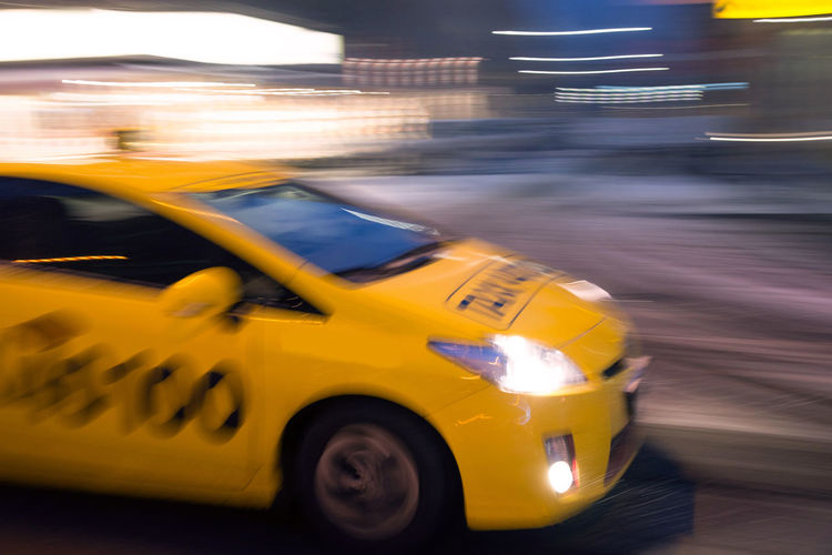 car moving fast in the night city in motion blur , evening Car Transportation Motion Taxi Mode Of Transportation Motor Vehicle Blurred Motion City Yellow Taxi Street Yellow Speed Road Architecture City Life City Street on the move Travel Illuminated No People
