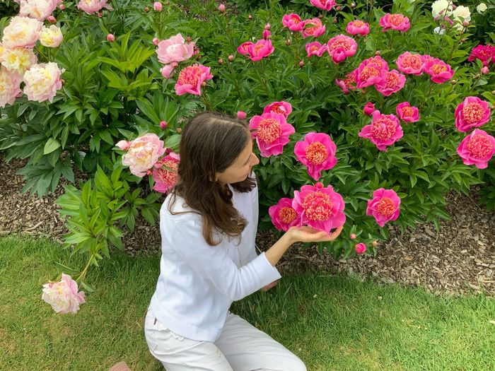 Plant Flower Flowering Plant One Person Real People Growth Nature Leisure Activity Beauty In Nature Day Pink Color Casual Clothing Women Lifestyles Fragility Freshness Green Color Outdoors