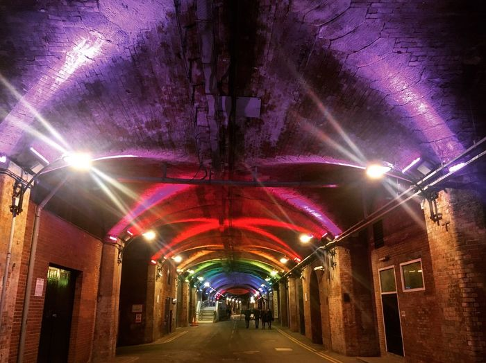 Illuminated The Way Forward Lighting Equipment Ceiling Diminishing Perspective Tunnel Architecture Built Structure Arch Walking Dark Arches Leeds Railway Indoors  Purple Night Light Beam Walkway AI Now The Graphic City Adventures In The City HUAWEI Photo Award: After Dark #urbanana: The Urban Playground Capture Tomorrow