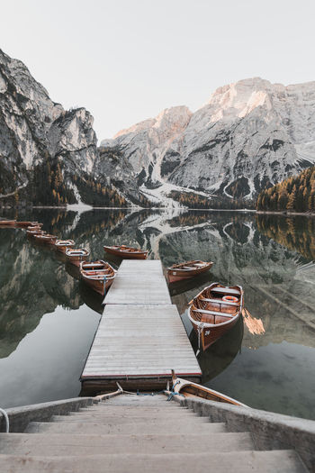 Calm mornings in Braies. Mountain Water Scenics - Nature Nature Beauty In Nature Mountain Range Lake Day No People Transportation Tranquility Sky Tranquil Scene Nautical Vessel Non-urban Scene Cold Temperature Winter Wood - Material Outdoors Rowboat Boat Tranquility Reflection Habour Sailboat Sailing Calm Peaceful Calm Water Reflections In The Water Reflection Lake Steps And Staircases Steps Autumn Autumn colors autumn mood Autumn Leaves