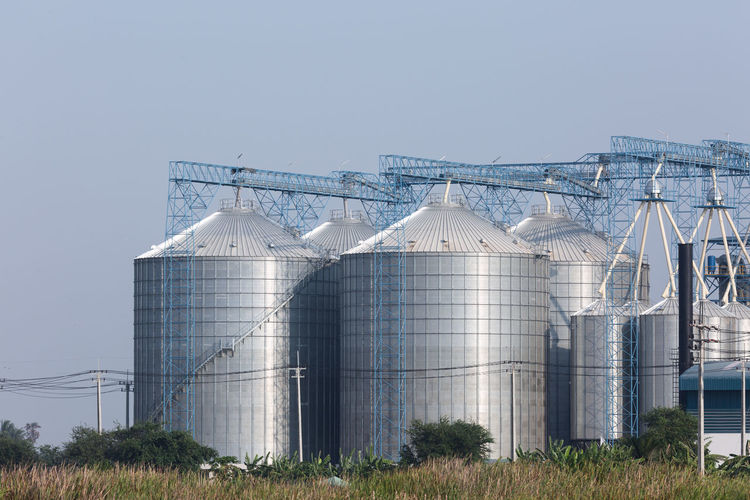 Silo Sky Storage Tank Nature Factory Industry Agriculture Plant Copy Space Blue No People Day Storage Compartment Architecture Clear Sky Food And Drink Industry Land Built Structure Metal Outdoors Silver Colored Fuel Storage Tank