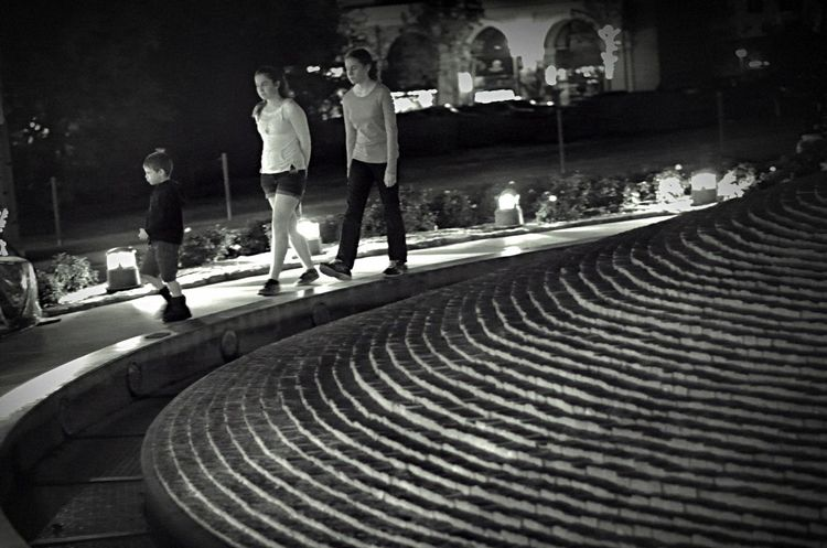 Walking along a dry fountain in the dark Real People Smcpentax55mmf18 Nightphotography Night Blackandwhite Monochrome