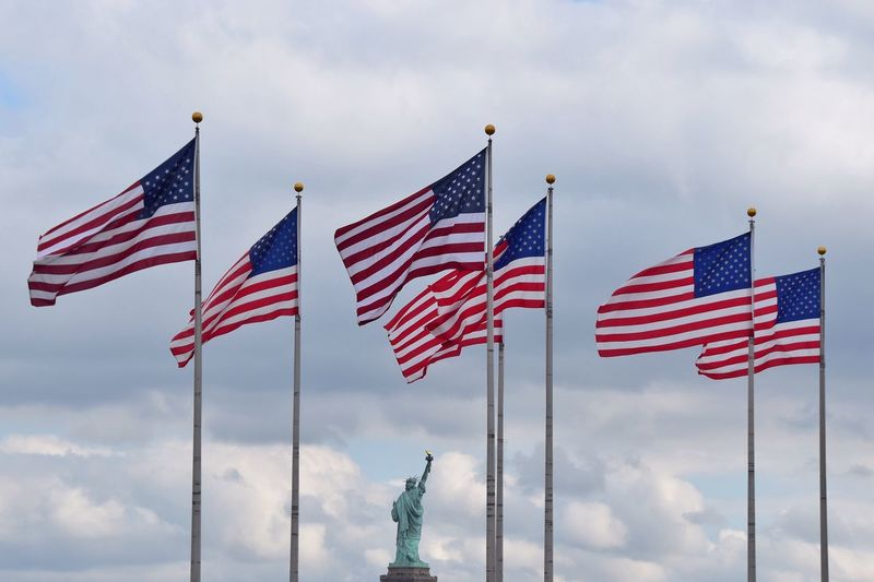 American flag against statue of liberty
