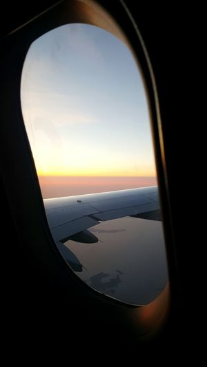 Showcase March From My Point Of View Unedited The Purist View From The Airplane Window Sunrise And Clouds Transportation Interesting Perspectives No People Cruisingaltitude A Bird's Eye View Millennial Pink Long Goodbye Let's Go. Together. Done That. Go Higher