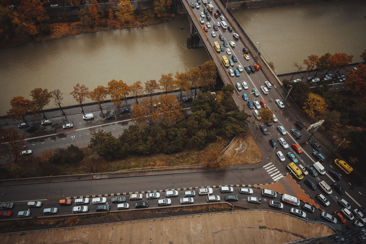 Transportation Car Motor Vehicle Mode Of Transportation Road Architecture High Angle View City Tree Land Vehicle Built Structure Connection Water Nature No People Bridge Plant Bridge - Man Made Structure Street Outdoors Multiple Lane Highway
