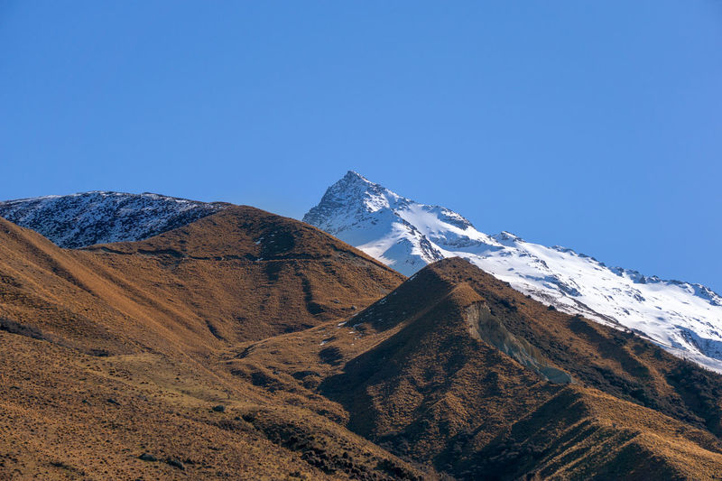 Peak of the mountain cover with snow, captured in New Zealand Mountain Sky Clear Sky Snow Scenics - Nature Beauty In Nature Winter Cold Temperature Blue Tranquil Scene Mountain Range Tranquility Snowcapped Mountain Copy Space Environment Day Nature No People Landscape Mountain Peak Outdoors