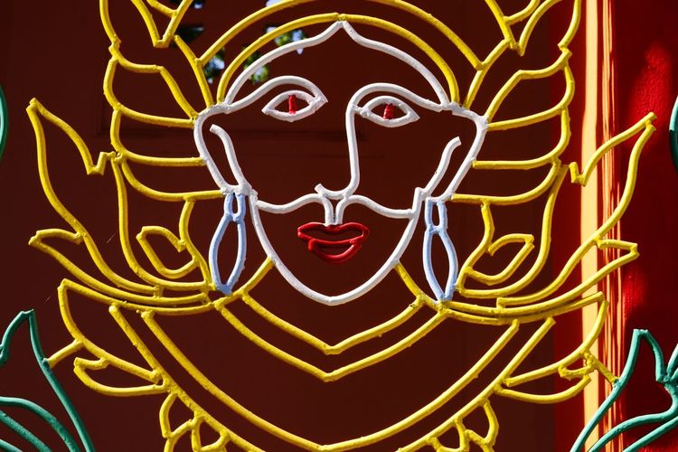 Woman's face sculture in metal gate at Buppharam Buddhist Temple, Penang, Malaysia. Red Outdoors Buddha Place Of Worship Nawfal Penang, Malaysia Statue Beauty Sky Spirituality Cultures Tradition Travel Destinations Architecture Buddha Statues