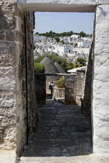The magic of Alberobello's Trulli travel location - It was really amazing to know this particulars constructions full of charming and to ear the history about the Alberobello's Trulli in the Italy Apulia region (Puglia). The history said that the Alberobello's origins date back to the Middle Age. The settlers built the houses with stone and without cement and with the easiest way to demolish them in the case of an inspection by the Kingdom of Naples, thus avoiding paying taxes. Another interesting thing is the decorative pinnacles and symbols painted on many roofs of the trulli that were often used to identify the different religions of their inhabitants. Albelobelo Italia Puertas Viajes  2019 EyeEm Awards The Traveler - 2019 EyeEm Awards The Architect - 2019 EyeEm Awards The Photojournalist - 2019 EyeEm Awards The Street Photographer - 2019 EyeEm Awards Italy EyeEm Gallery EyeEm Best Shots Eyeem4photography Architecture Built Structure Building Exterior Building Day City Travel Destinations History Travel Tourism The Past Town Ancient Nature Old Wall Wall - Building Feature Outdoors Residential District House Stone Wall Ancient Civilization