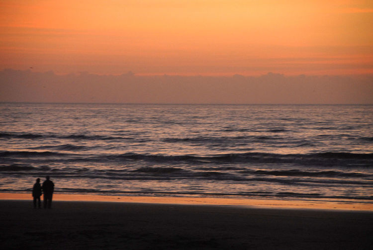 A walk along the beach. Gulf Coast Texas Beach Beauty In Nature Full Length Horizon Over Water Leisure Activity Lifestyles Nature Orange Color Outdoors Real People Sand Scenics Sea Silhouette Sky Standing Sunset Tranquil Scene Tranquility Travel Destinations Vacations Water Wave