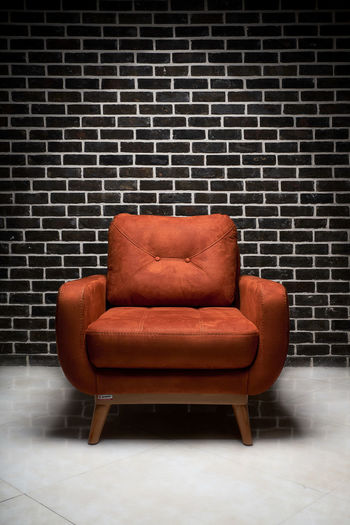 Absence Architecture Armchair Brick Brick Wall Brown Chair Comfortable Cozy Domestic Room Empty Flooring Furniture Indoors  Leather Living Room No People Relaxation Seat Sofa Wall Wall - Building Feature