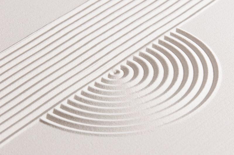 High angle view of design on sand