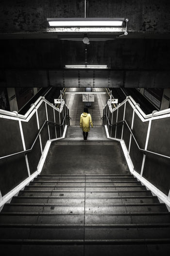 Rear view of person on staircase at subway station