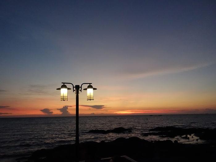 Beautiful Nature Dawn Light Lamplight Evening Sky Romantic Water Sea Sunset Beach Technology Silhouette Street Light Illuminated Sky Horizon Over Water Seascape Tide Low Tide Romantic Sky Dramatic Sky