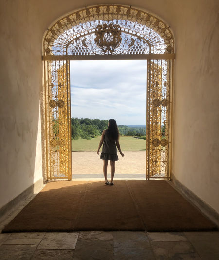 Girl standing in arch