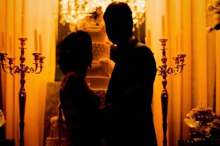 Silhouette Bride And Groom Standing Together