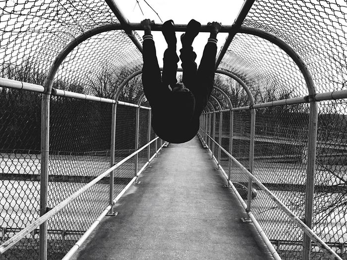 Spider Bat• Fence Chainlink Fence Real People One Person Railing Rear View Leisure Activity Full Length Outdoors Day Sky Men Architecture Jungle Gym People Adapted To The City Urban Geometry Spider Web Spiderweb Comic Lines Black And White