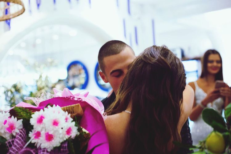 Bride and bridegroom kissing during wedding ceremony