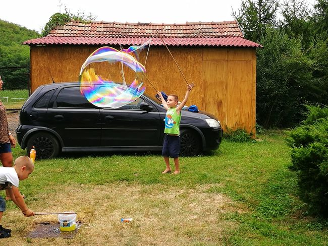 Full Length Outdoors Day Fun Real People Standing People Grass Boys Adult Men One Person Tree Bubble Wand Only Men Hungary