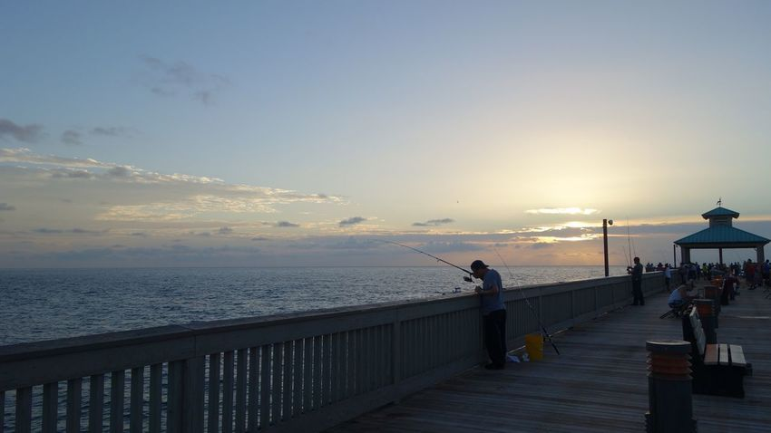 Morning Pier Fishing Sea Pier Horizon Over Water Water Railing Scenics Nature People Fishing Sunset Beauty In Nature Sky Idyllic Real People Beach Tranquility Fishing Pole Leisure Activity Weekend Activities Outdoors Full Length Men