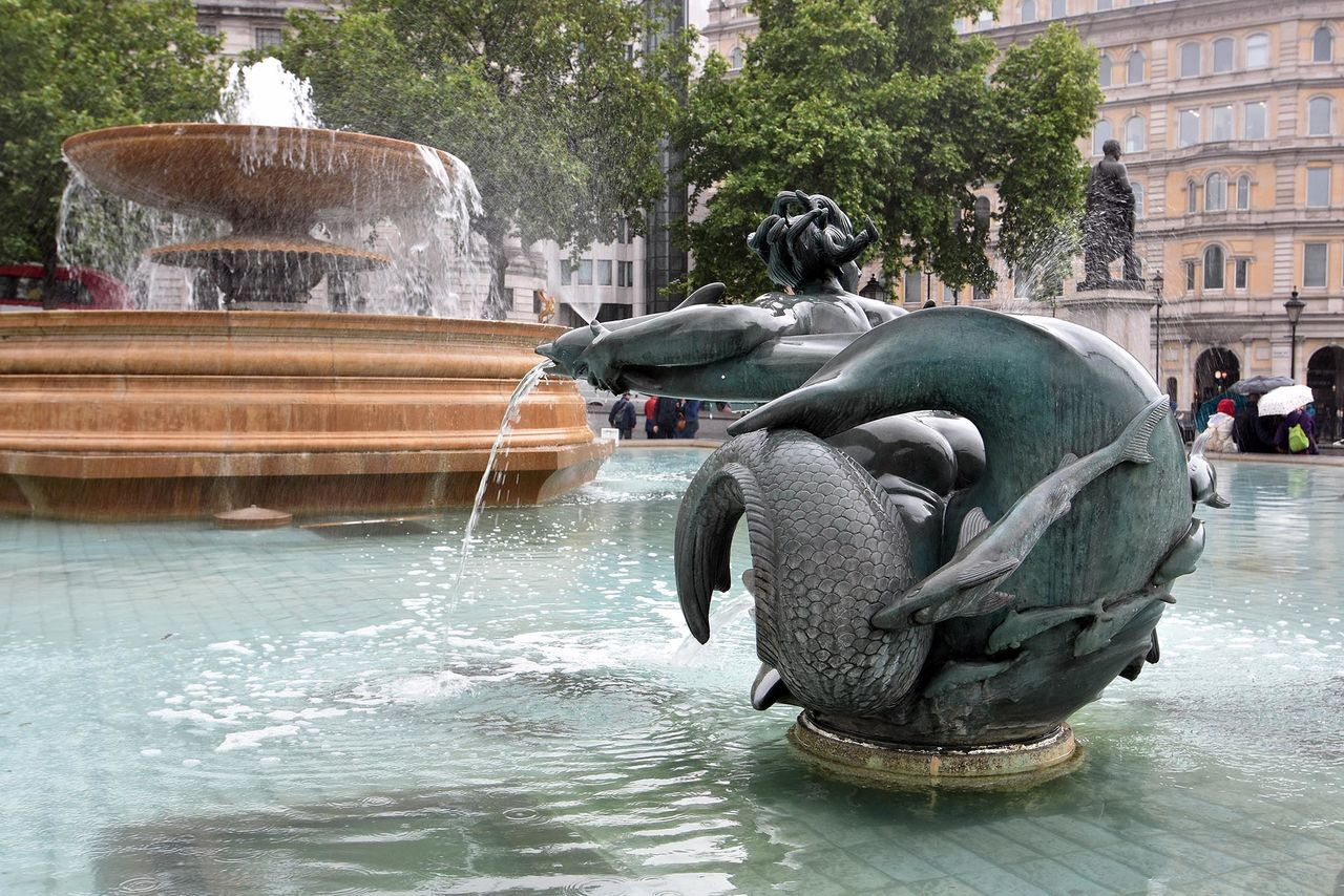 Fountain In Front Of Historic Building At Trafalgar Square