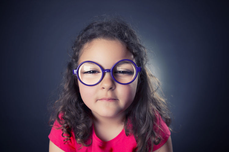 Myopic girl Brown Hair Child Childhood Children Only Cute Eyeglasses  Girls Headshot Myopic One Person Portrait Studio Shot