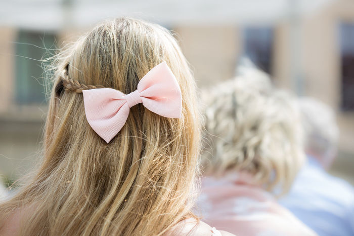 Blonde Hair Bow Ceremony Close-up Festive Focus On Foreground From Behind Guest Hair Bow Hairstyle Headshot Human Hair Long Hair Outdoors Part Of Pastel Pink Rosé Selective Focus Sunny Wedding Wedding Ceremony Wedding Day Woman Real People