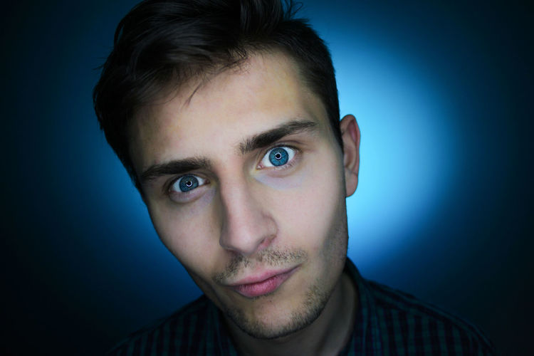 Blue Blue Background Close-up Colored Background Day Headshot Human Body Part Human Face Men One Man Only One Person One Young Man Only Only Men People Portrait Studio Shot Young Adult