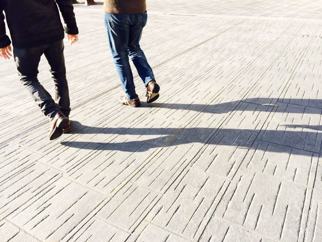 Architectural Design Low Section Shadow Person Walking Sunlight Motion Lifestyles On The Move Men Human Foot Day Outdoors Simetry Simplicity Architecture And Art
