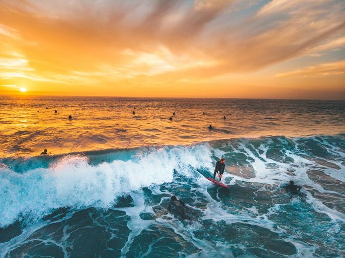 Sunset surf sesh Best EyeEm Shot Best Shots EyeEm California Bestoftheday California Dreamin Drone  Best Of EyeEm Sunset Sunset_collection Surf's Up Surf Sea Sky Water Sunset Sport Beach Lifestyles Beauty In Nature Real People Leisure Activity Aquatic Sport Orange Color Motion Outdoors