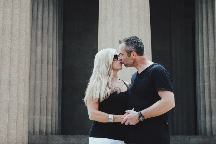 Love Togetherness Real People Kissing Embracing Two People Bonding Hugging Couple - Relationship Lifestyles Day Standing Young Women Young Adult Arm Around Outdoors Leisure Activity Affectionate Men Groom