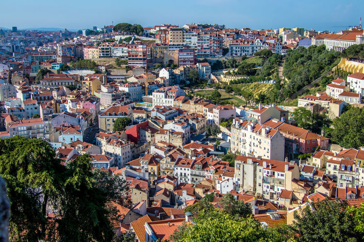 High angle view of houses in Lisbon, Portugal Cityscape Lisbon - Portugal Lisbon Cityscape Lisbon Streets Lisbon, Portugal Architecture Building Building Exterior Built Structure City Cityscape Community Crowded High Angle Vew High Angle View Lisbon Lisbon Portugal Residential District Roof Town TOWNSCAPE Tree