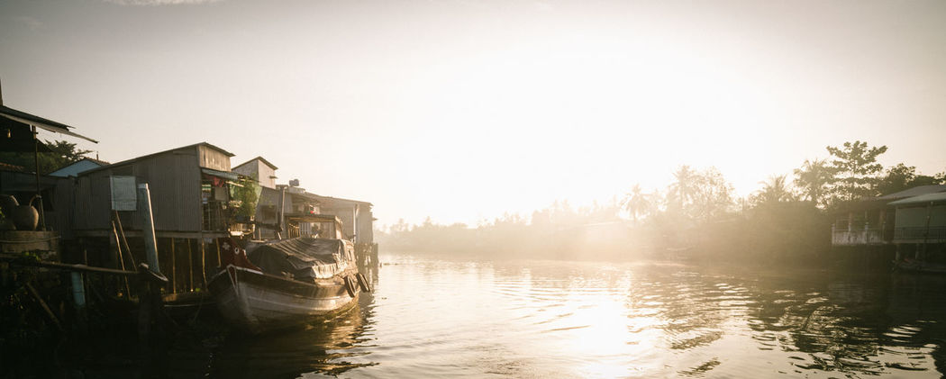 Sunrise in Ben Tre, Vietnam ASIA Bentre,vietnam Boat Building Exterior Clear Sky Day Lake Light Mekong Mekong Delta Mekong River Nature Nautical Vessel No People Outdoors Reflection River Riverside Sky Sun Sunrise Sunset_collection Tree Vietnam Water