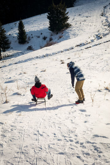 Winter specific activities Snow Cold Temperature Winter Nature Day Warm Clothing Slide Sliding Board Slide Slide Board Snowcapped Mountain Slope Sleigh Pine Trees Holiday Wintertime Winter Wonderland Fun Sport Sports Photography Riding Scenery In Motion Sonyrx100 Ride