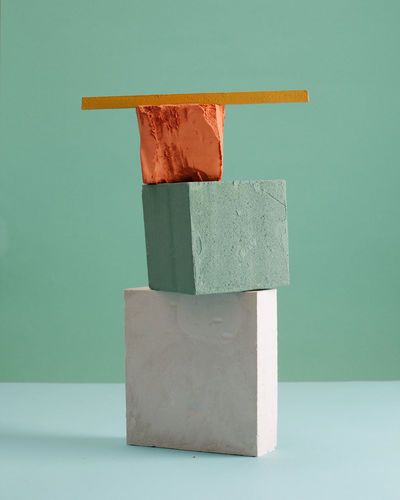 Close-up of stone stack on table against wall