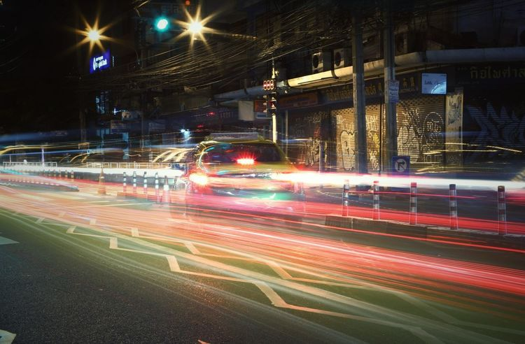 Night Illuminated City Street City Blurred Motion Motion Long Exposure Speed Traffic Street Street Light Outdoors Light Trail City Life No People Nightlife Building Exterior Cityscape The Street Photographer - 2017 EyeEm Awards Cityscape City The Great Outdoors - 2017 EyeEm Awards Clock Landscape Tourism