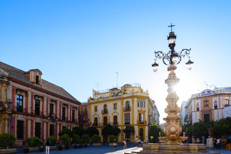Street scenery on a summer day in Sevilla, Spain SPAIN Sevilla Travel Traveling Architecture Buildings Built Structure City Clear Sky Day First Eyeem Photo Outdoors Sculpture Sky Statue Summer Travel Destinations