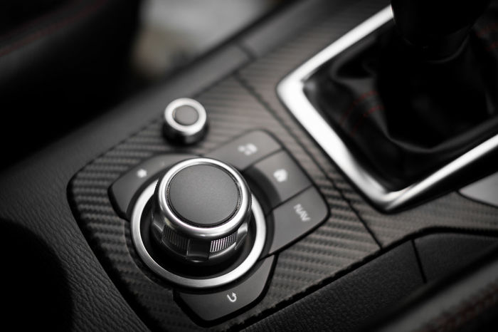Car center console with buttons of many function in modern car Adjust Audio Automotive Button Car Communication Connection Console Design Function Handsfree Index Indoors  Interior Luxury Modern Navigator  Panel Press Switch Technology Volume