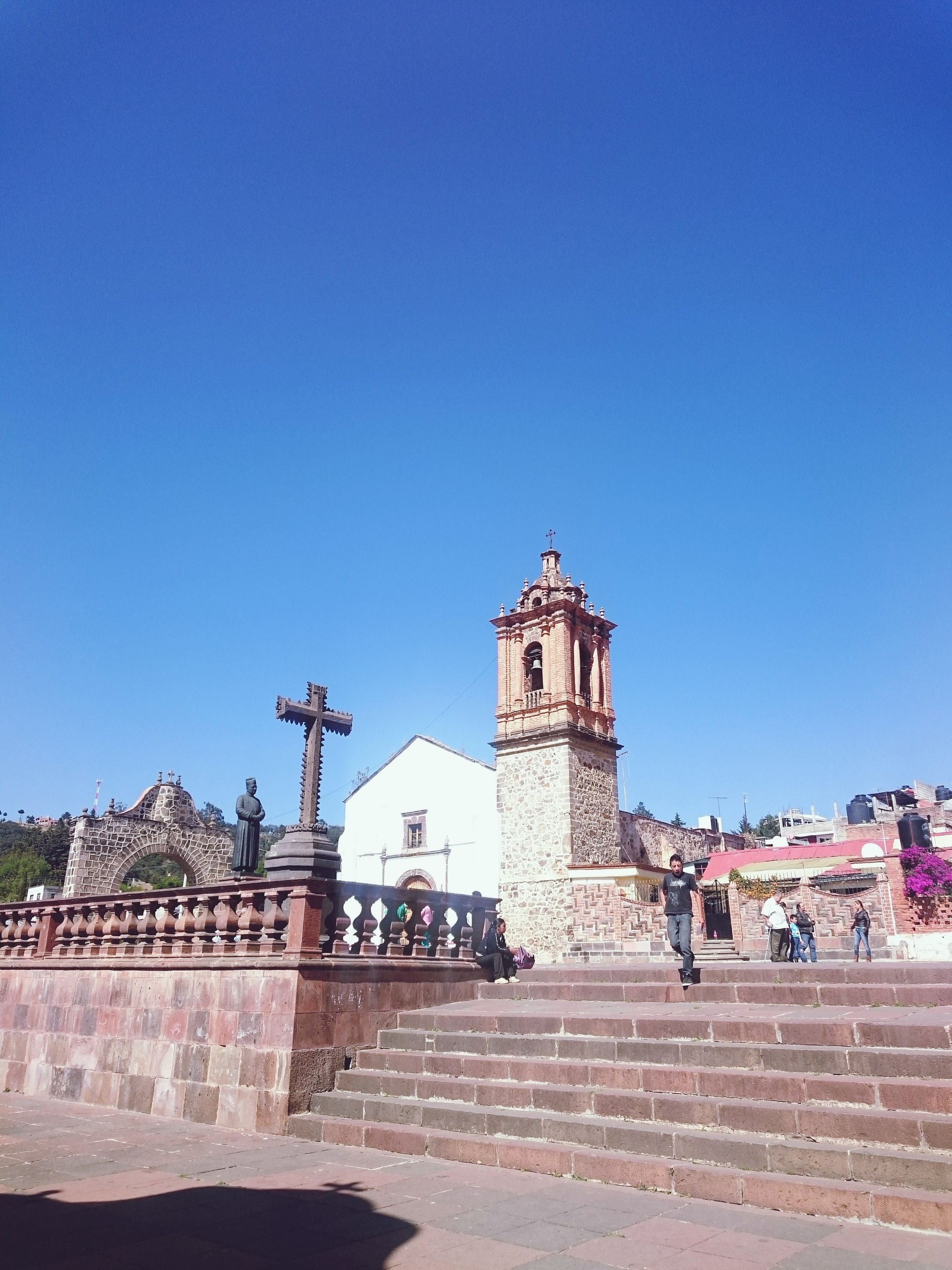 clear sky, architecture, built structure, building exterior, copy space, blue, religion, place of worship, low angle view, spirituality, history, church, steps, sunlight, travel destinations, famous place, day, outdoors, travel