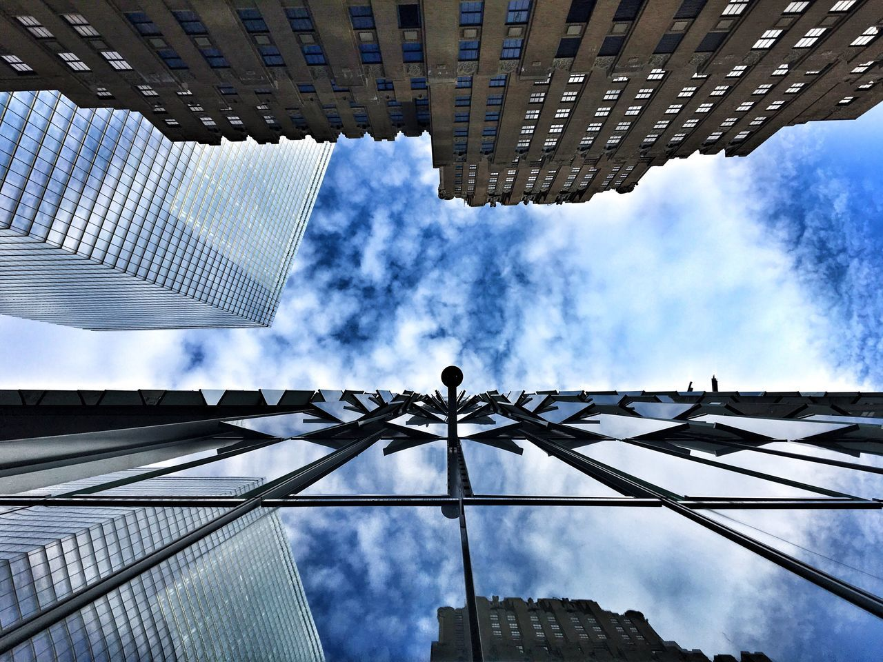 low angle view, architecture, cloud - sky, sky, built structure, building exterior, outdoors, day, no people, skyscraper, city