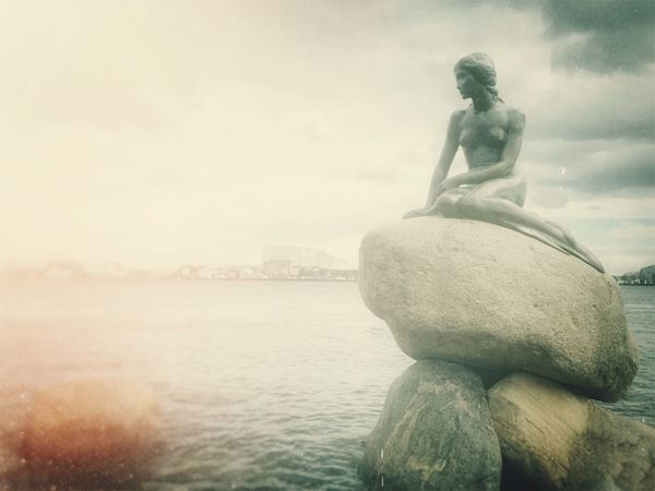 Copenhagen Denmark Den Lille Havfrue Little Mermaid  Human Representation Statue Art And Craft Sculpture Art Water Creativity Sky Sea Travel Destinations Cloud - Sky Day Tranquil Scene Tranquility Scenics Nature Waterfront Stone Material Tourism No People