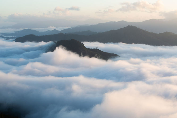 Scenic view of cloudscape mountains against sky