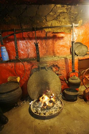 Flame Indoors  Old Fire Hearth Old Pot Cauldron Red Wall Old Teapot Vintage Vintage Cottage Cottage Cooking Cottage Fire Old LivingHeat - Temperature No People Country Home Country Fire Vintage House Fireplace Home Homely Atmosphere Homely Welcoming Fire Warm Home Red